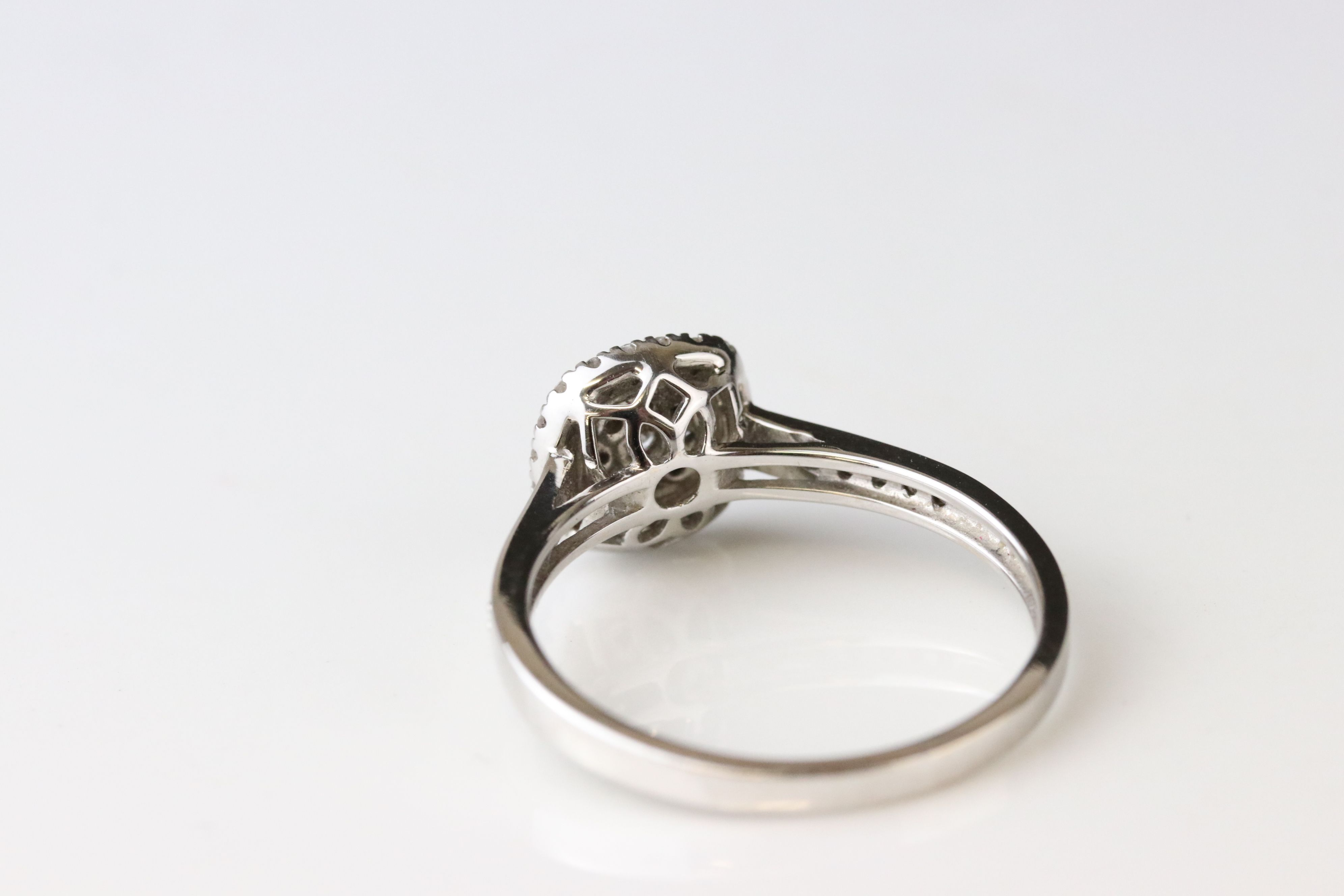Diamond cluster 18ct white gold ring, nine small round brilliant cut diamonds to central cluster, - Image 3 of 3