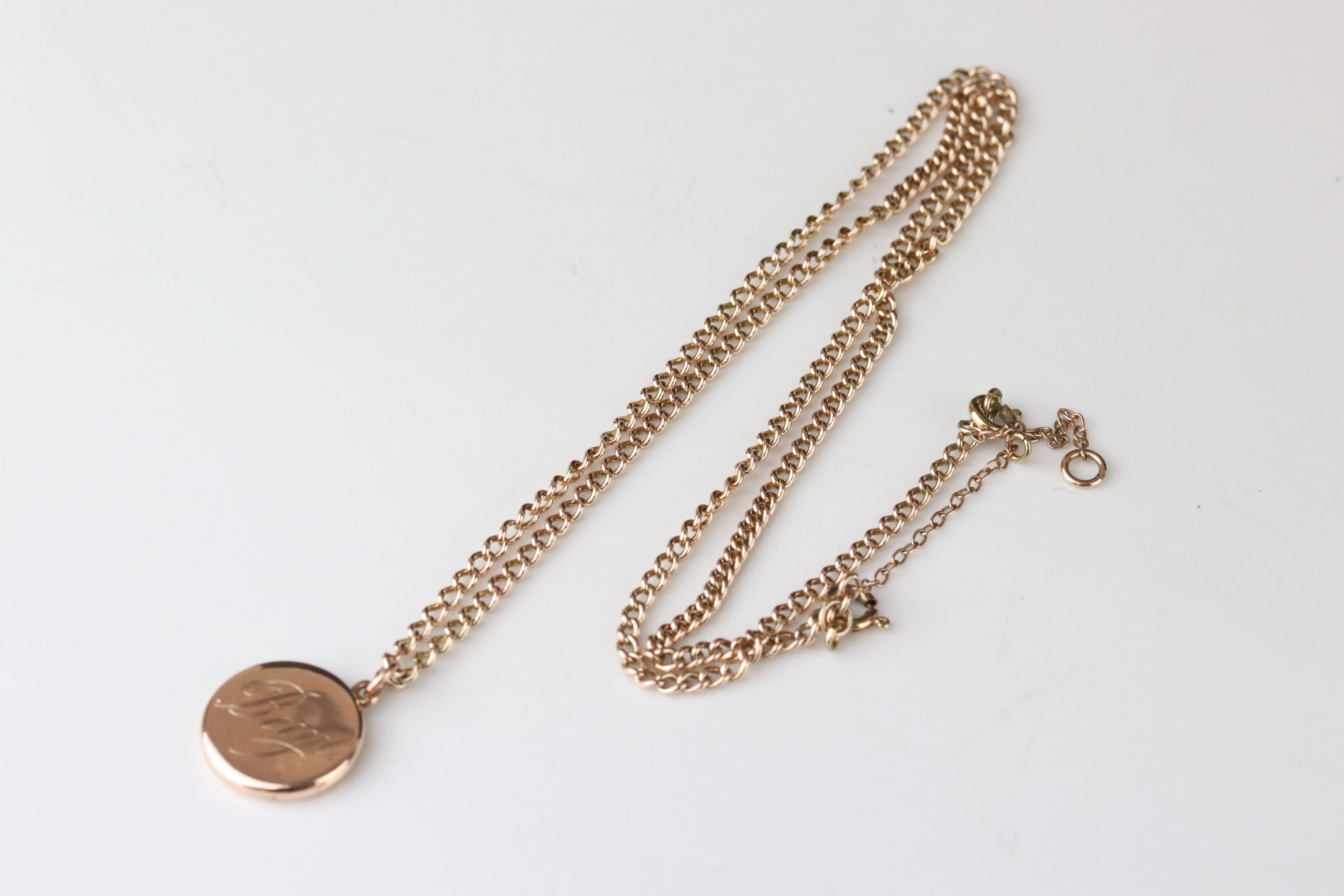 10ct yellow gold locket pendant engraved Beryl, containing hair to glazed compartment, on 9ct rose