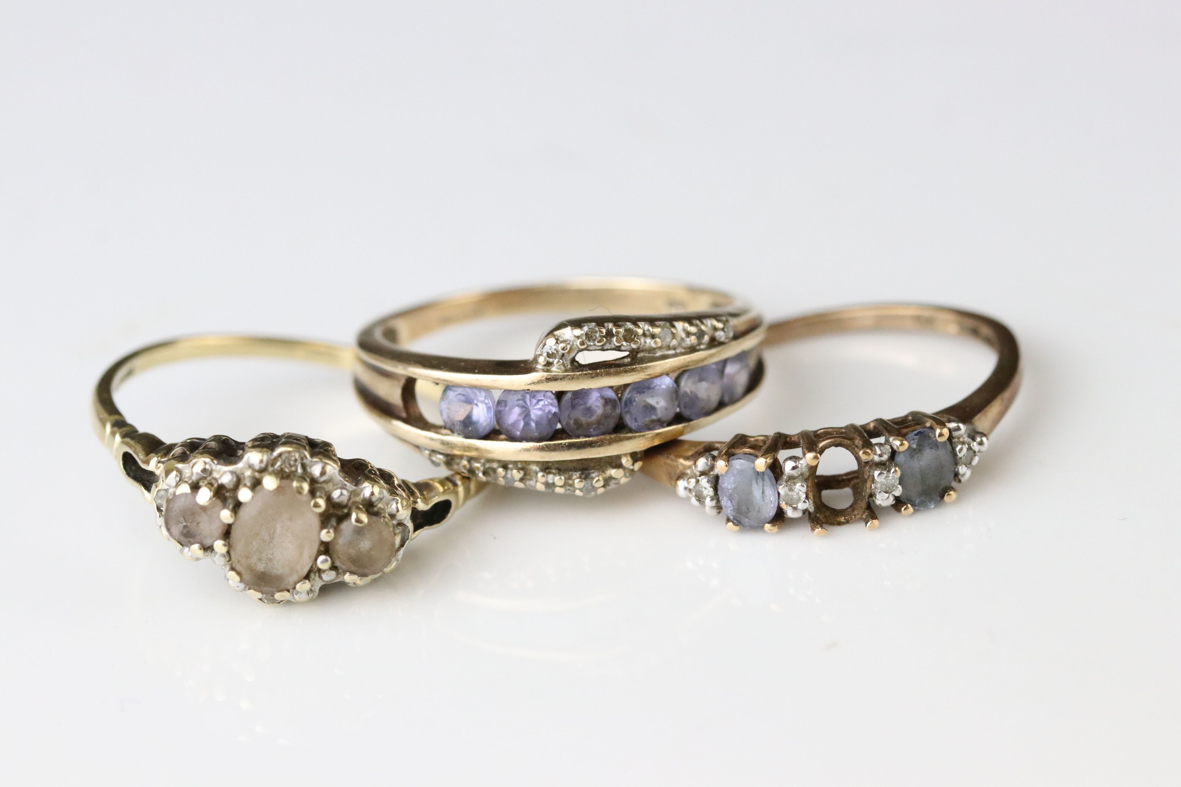 Three gem set 9ct yellow gold dress rings, all with gemstones missing