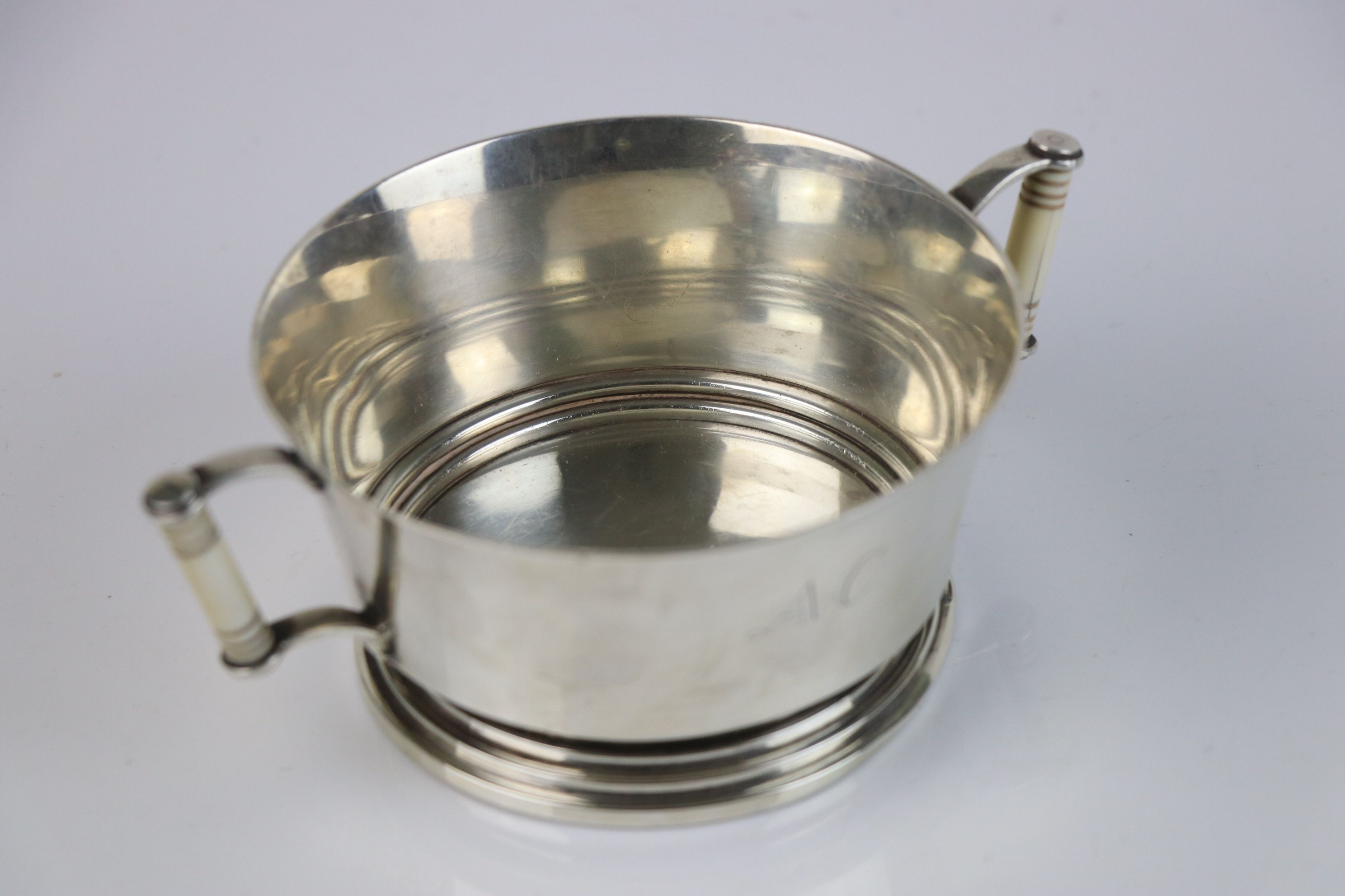 A fully hallmarked Britannia silver double handled christening cup with decorative ivory handles, - Image 3 of 5