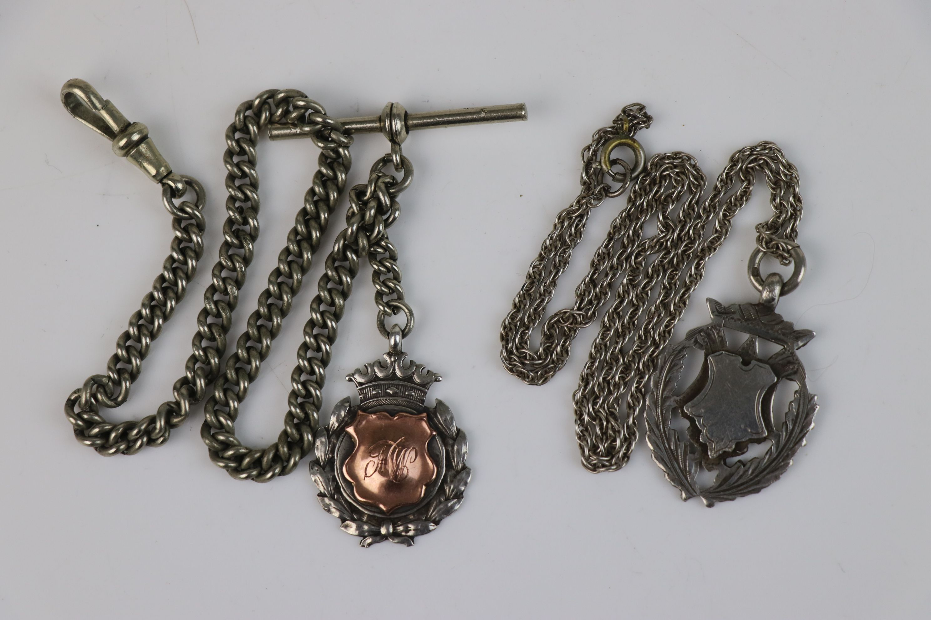 Two fully hallmarked sterling silver watch fob medallions together with an Albert chain.
