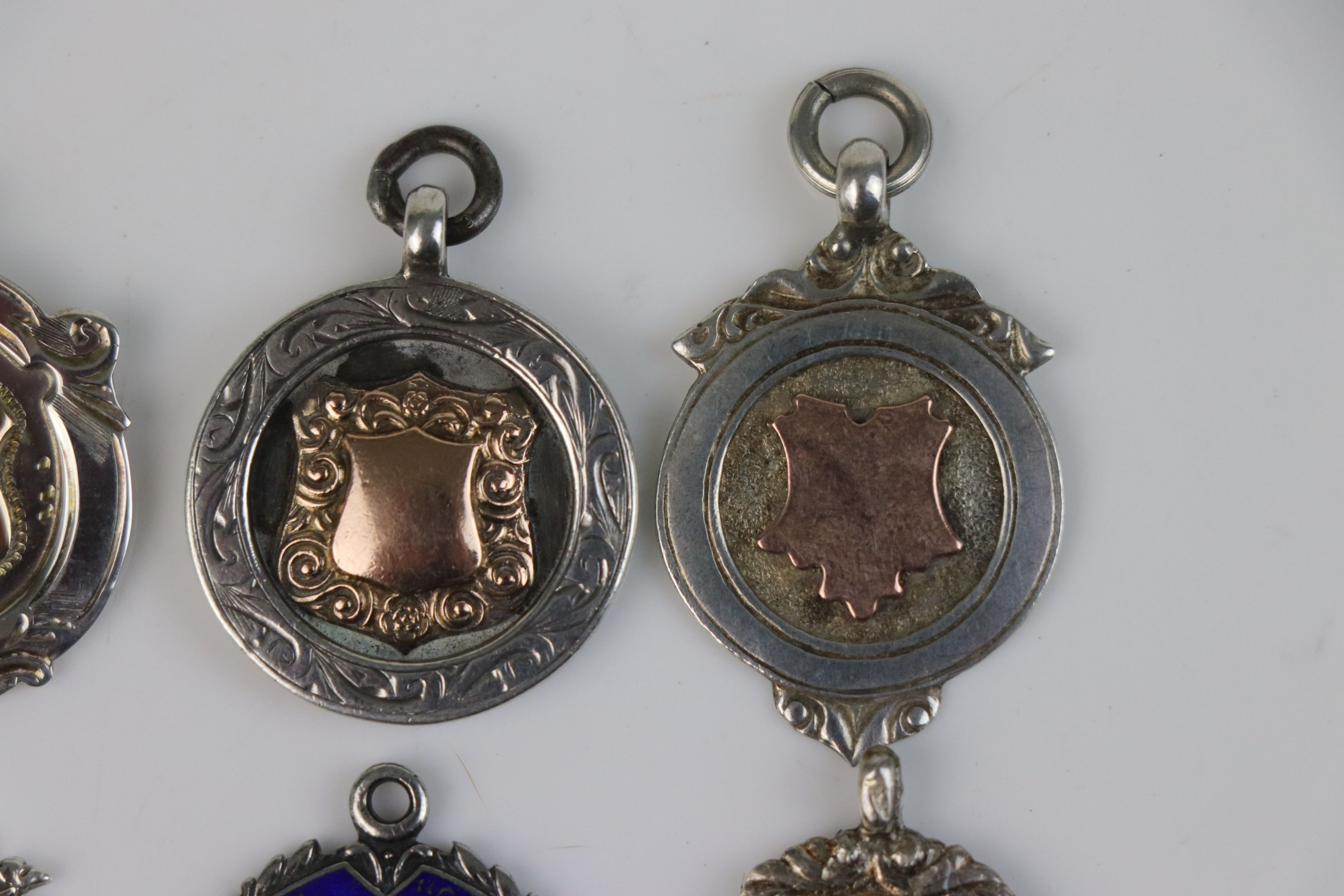 A collection of six fully hallmarked sterling silver watch fob medallions. - Image 4 of 7