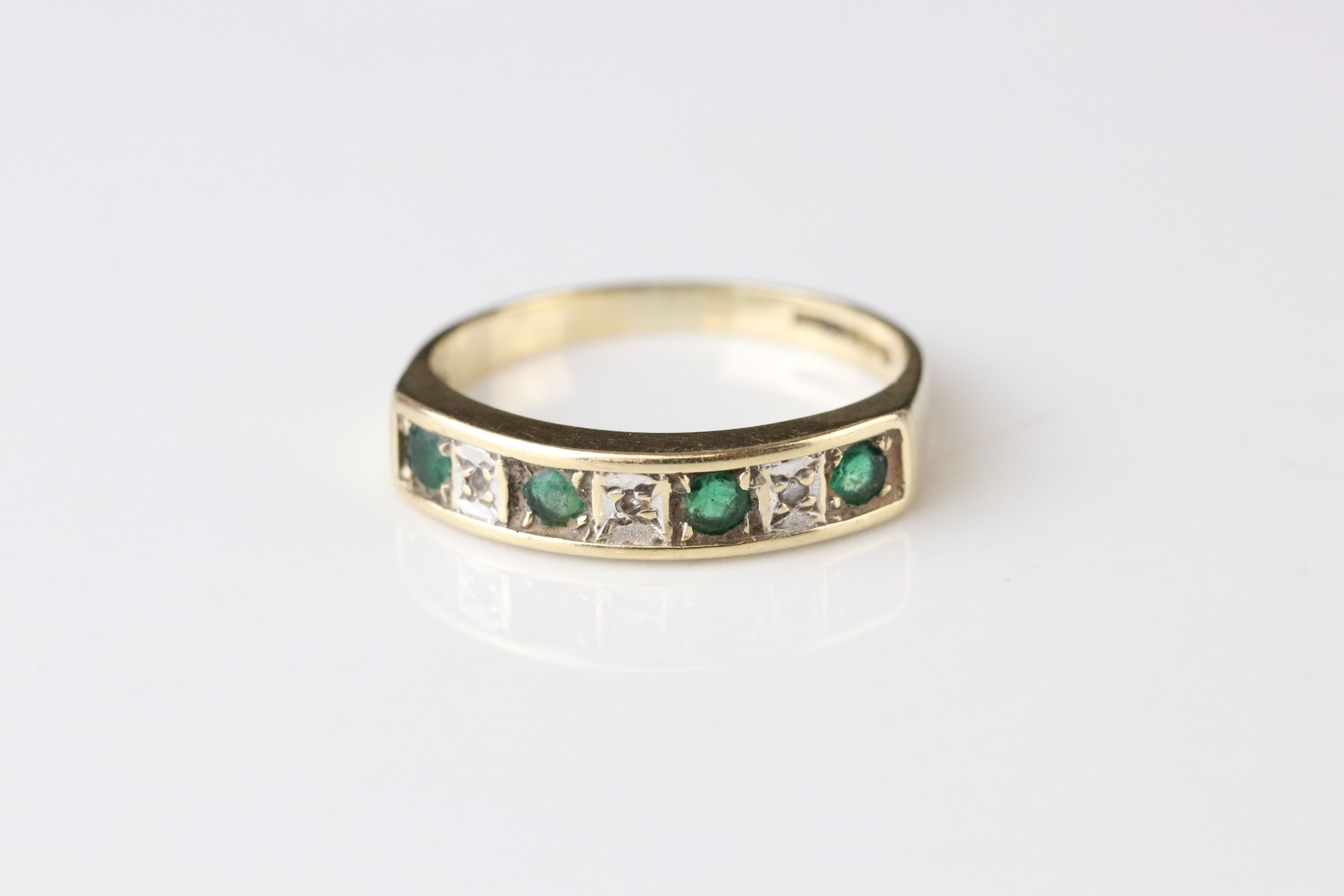 Emerald and diamond seven stone ring, four small round mixed cut emeralds and four small eight cut - Image 3 of 4