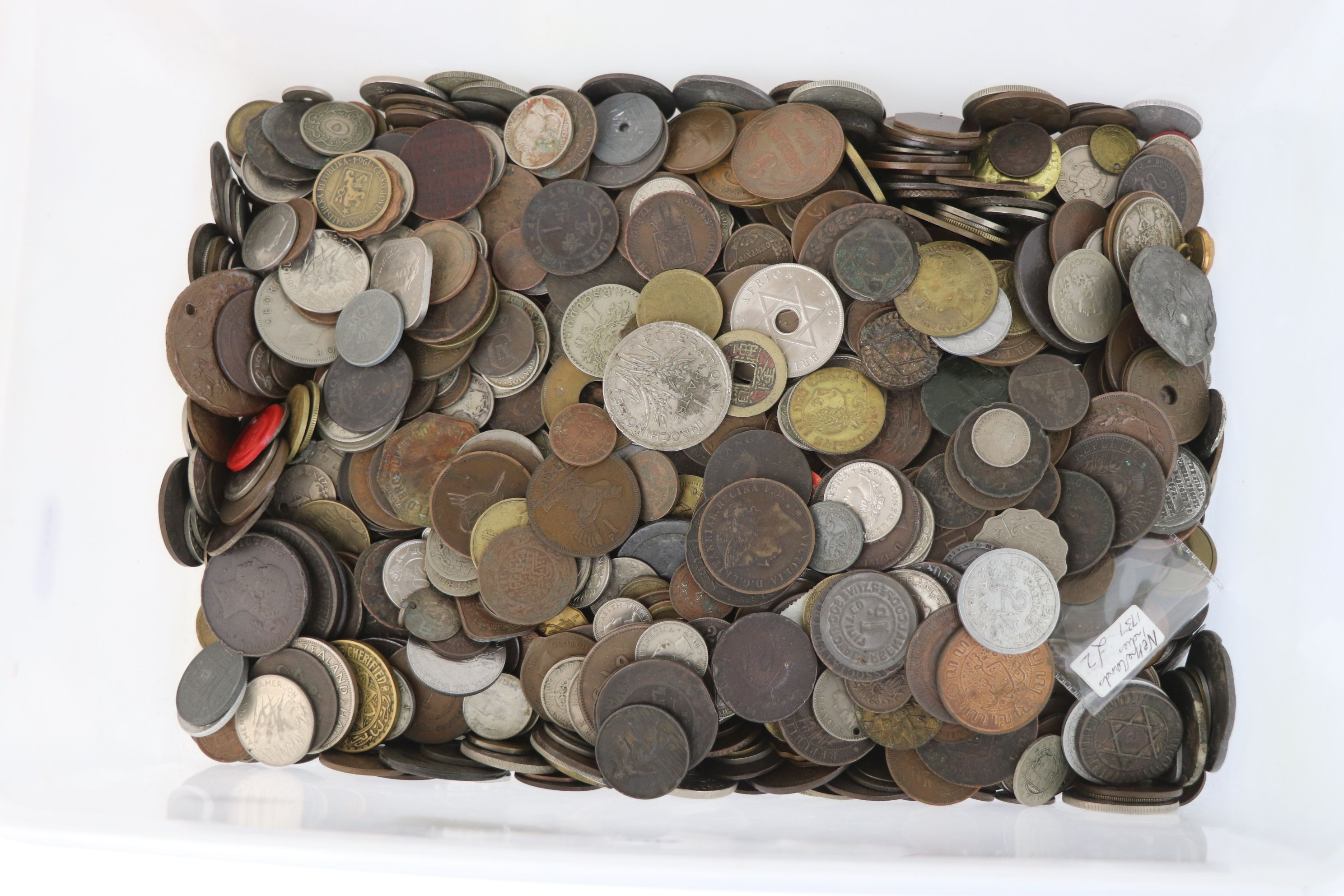 A large collection of British and World coins to include silver examples.
