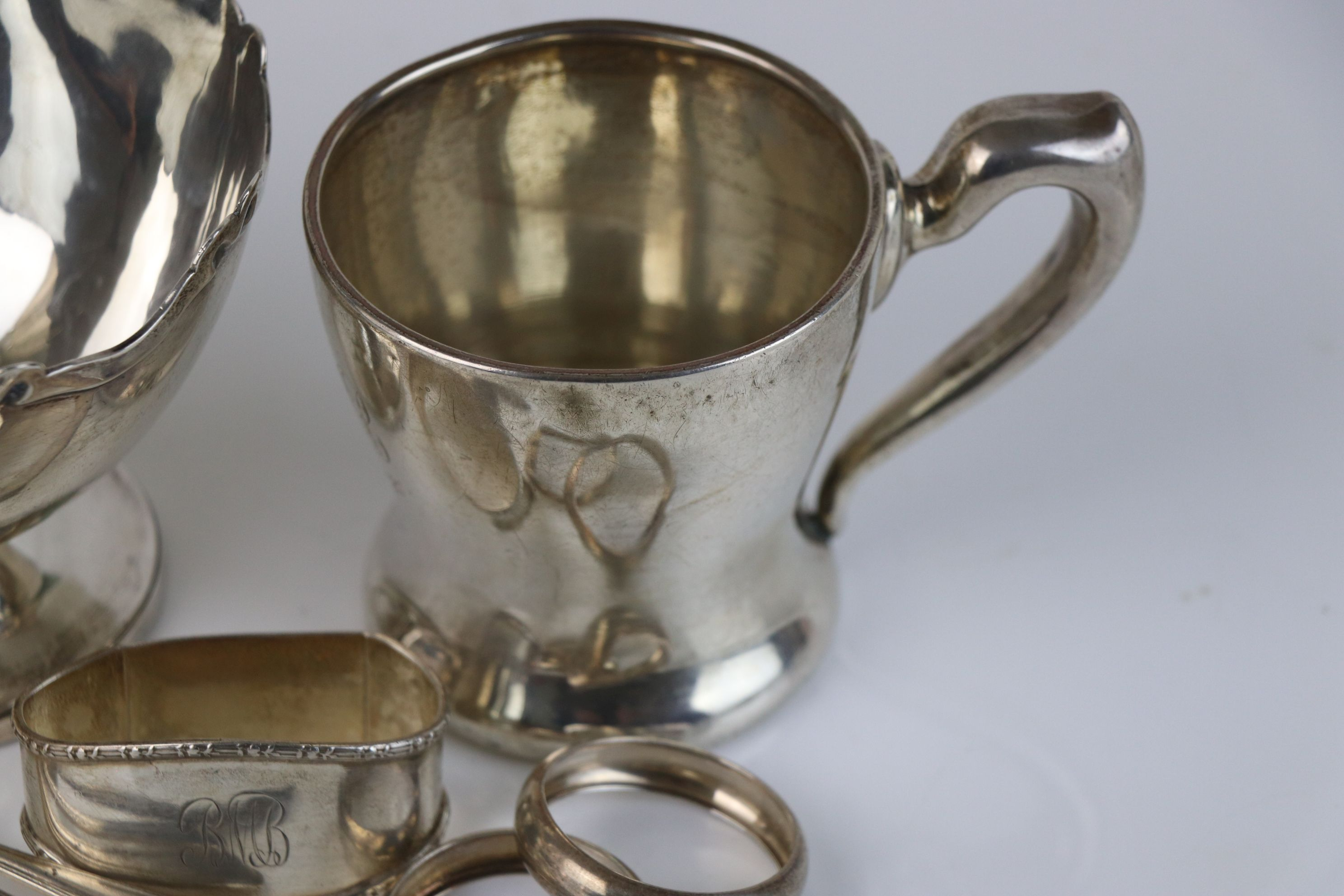 A collection of fully hallmarked sterling silver to include sugar bowl, cup, napkin rings and - Image 2 of 6