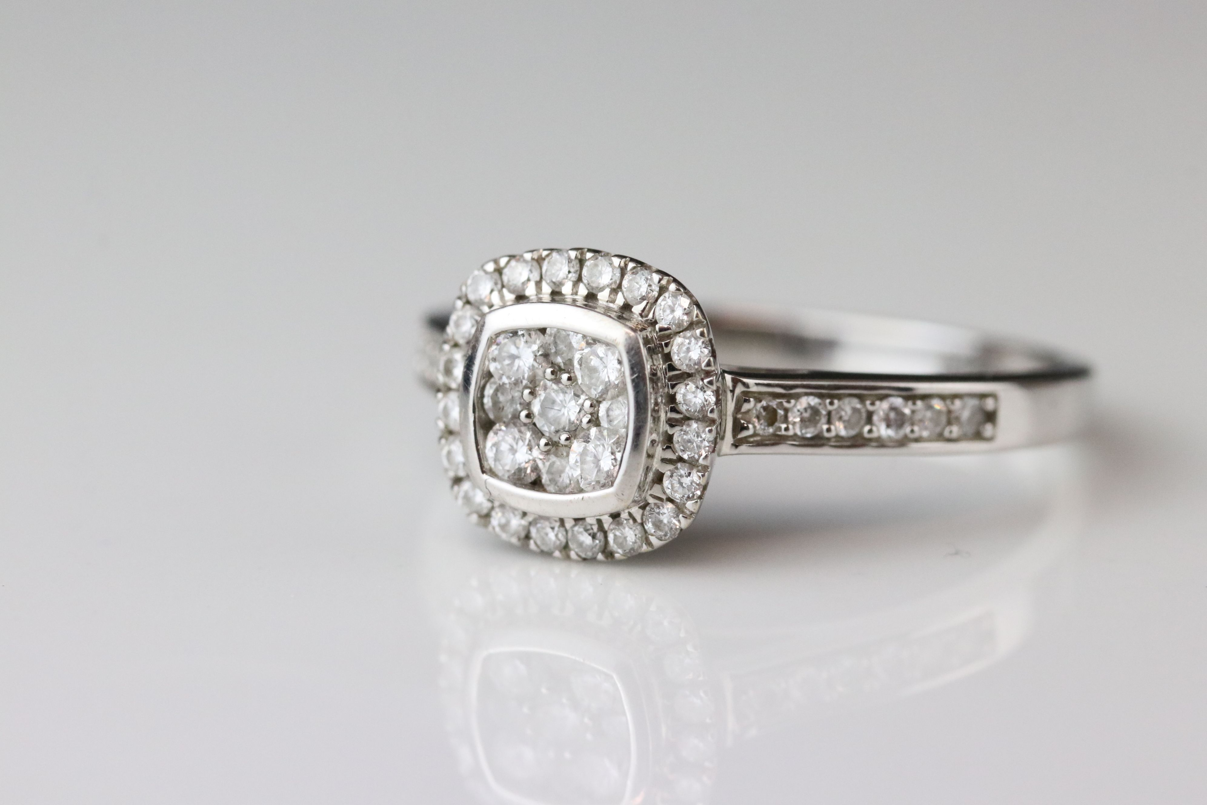 Diamond cluster 18ct white gold ring, nine small round brilliant cut diamonds to central cluster,