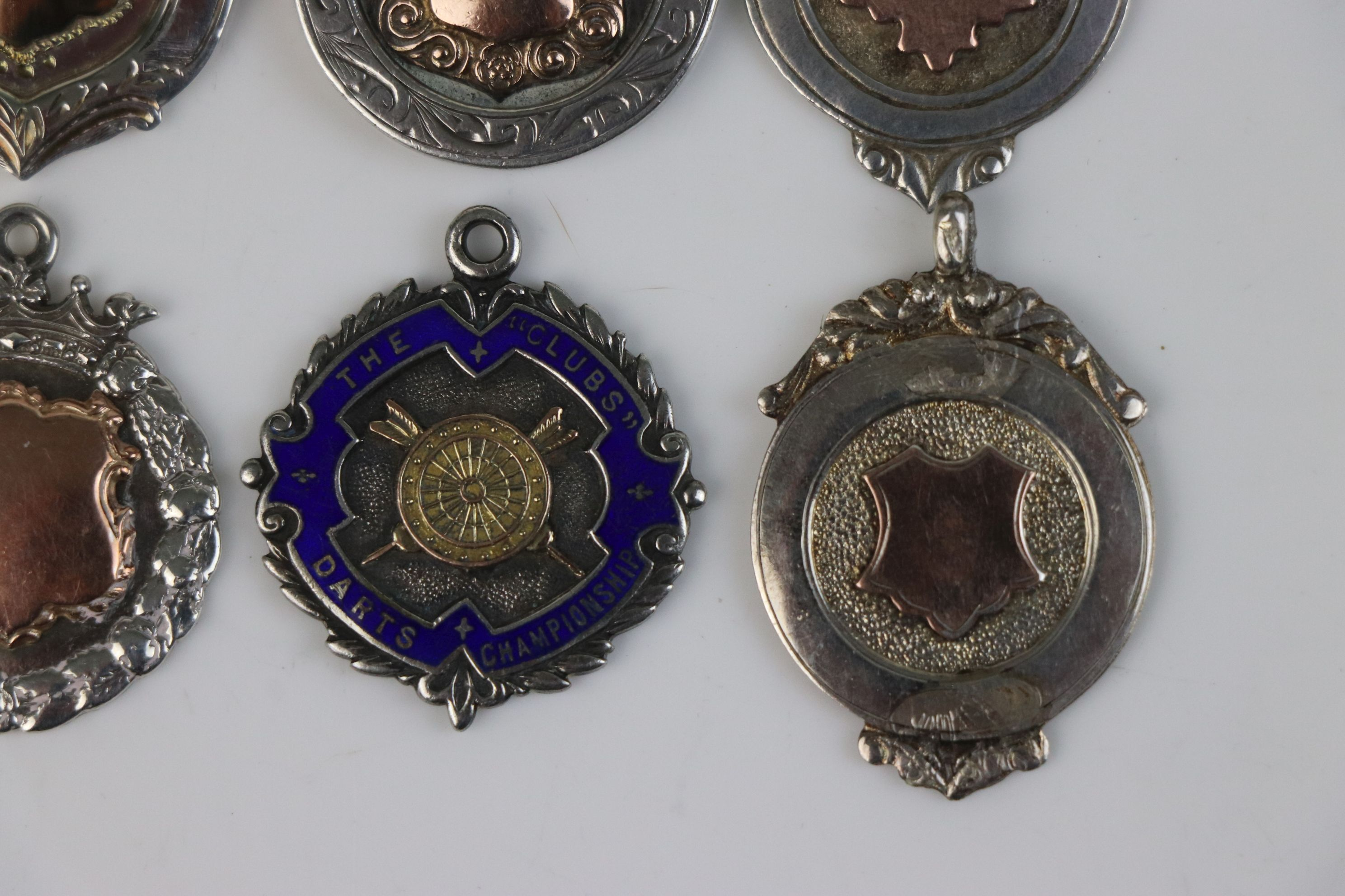A collection of six fully hallmarked sterling silver watch fob medallions. - Image 6 of 7