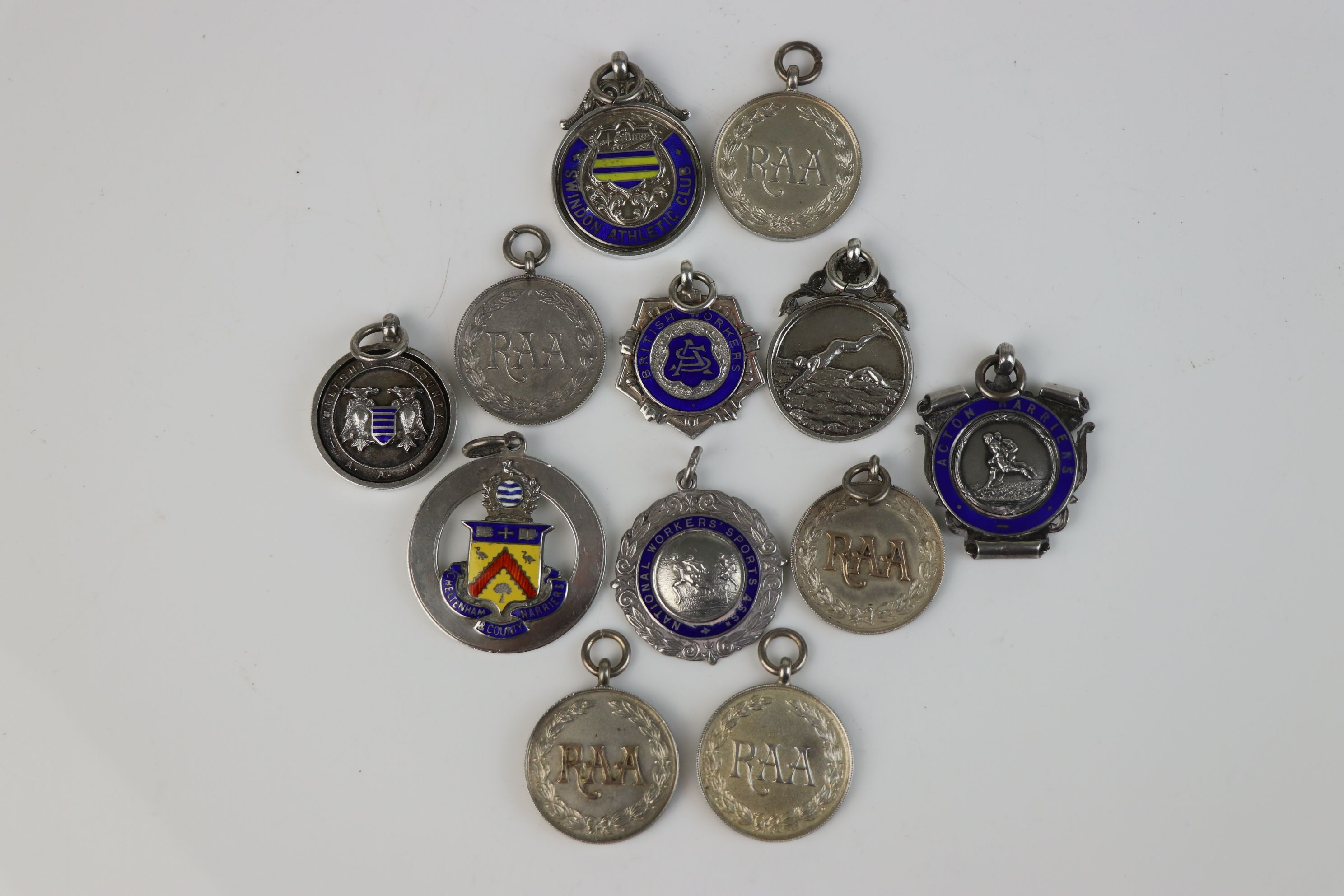 A collection of Twelve fully hallmarked sterling silver sports related watch fob medallions. - Image 2 of 9