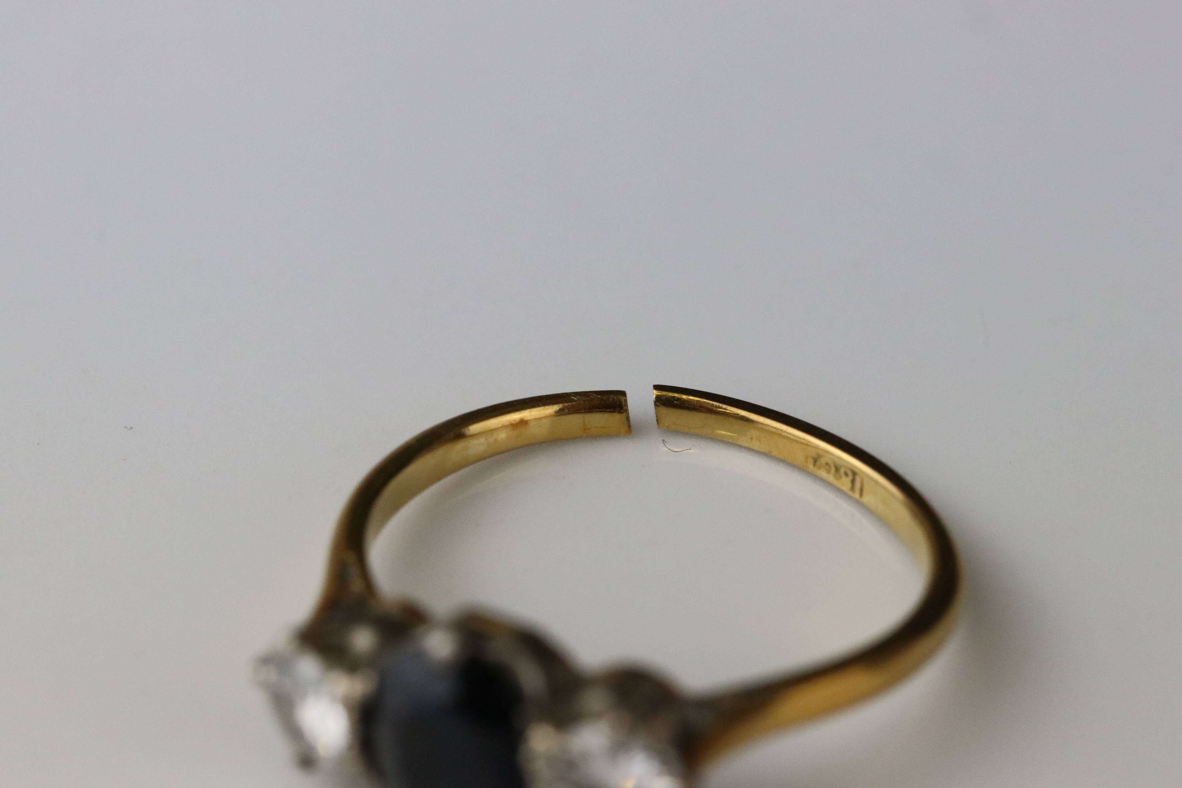 Sapphire and diamond three stone 18ct yellow gold platinum set ring, the oval mixed cut blue-black - Image 2 of 5