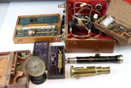 A box of mixed collectables to include a cased Soniscope, opium scales and cased Sikes Hydrometer.