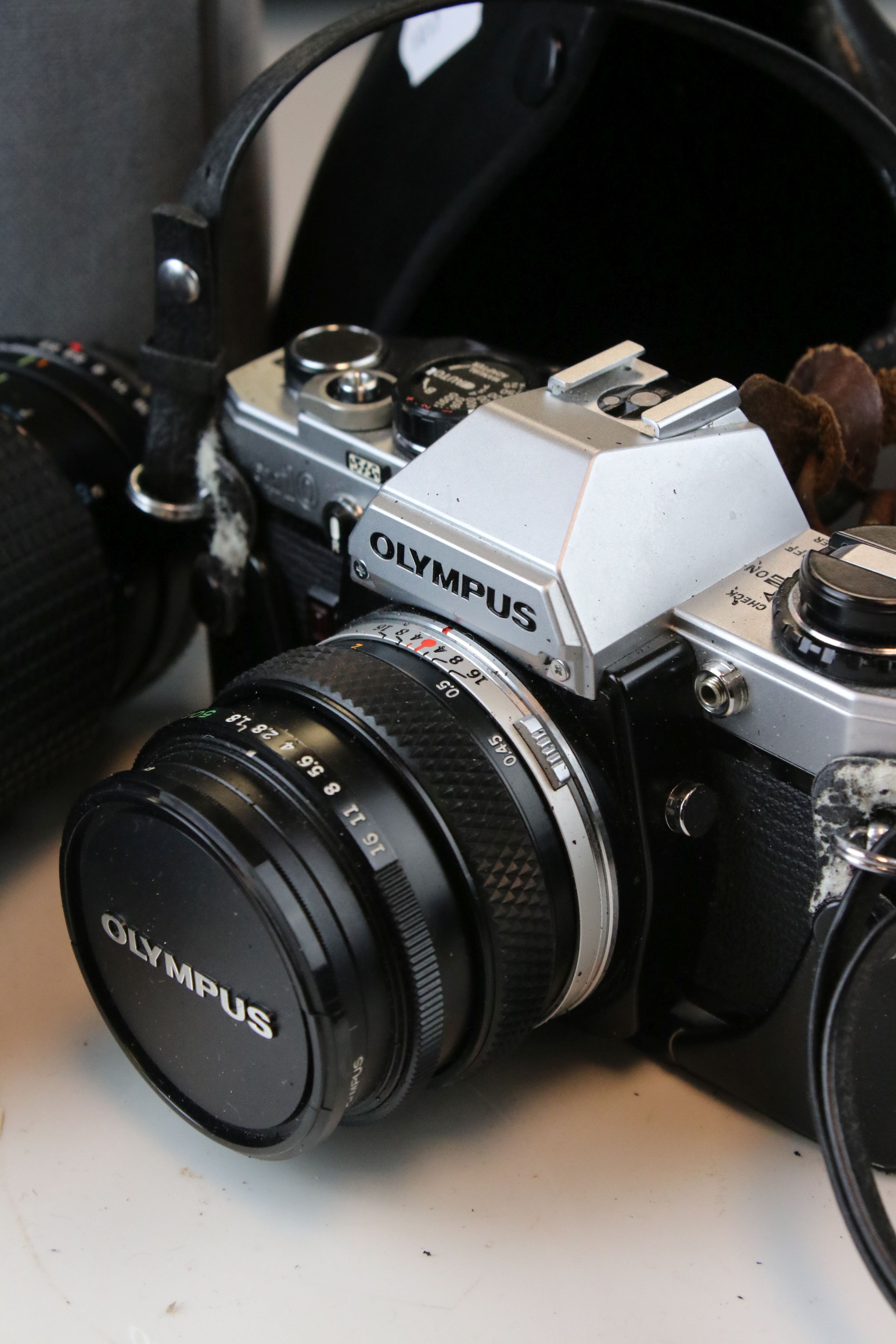 A collection of cameras and photographic equipment to include an Olympus OM10 35mm SLR camera. - Image 3 of 6