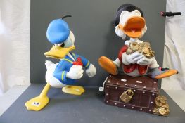 Two Disney large Donald Duck and Scrooge McDuck figures.