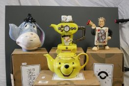 Four boxed collectable novelty teapots to include the Disney showcase collection Winnie the Pooh