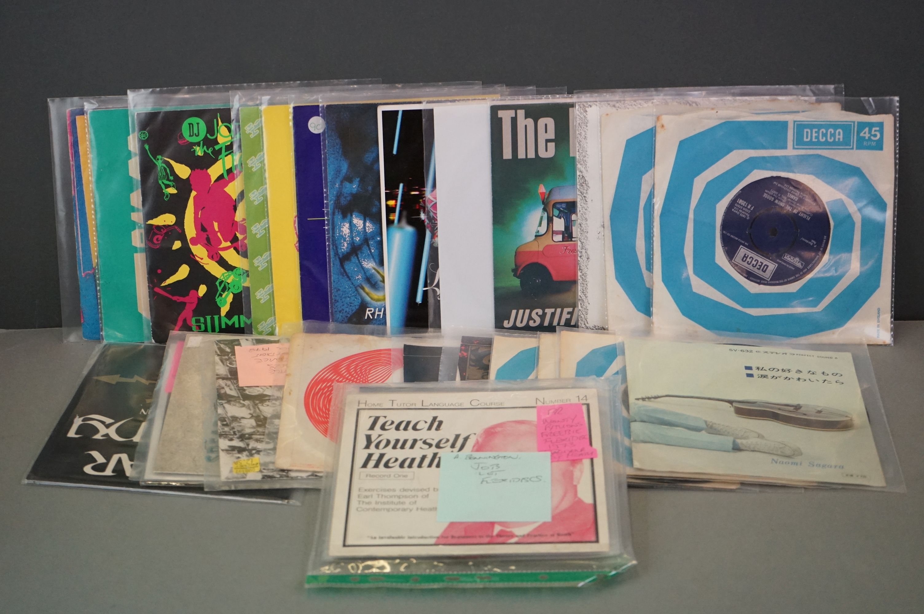 """Vinyl - Collection of approx 20 7"""" singles spanning genres and decades including 90's examples"""