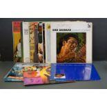 Vinyl - World Music - Around 15 LPs to include Mary Kante, Ravi Shangkar etc, sleeves and vinyl vary
