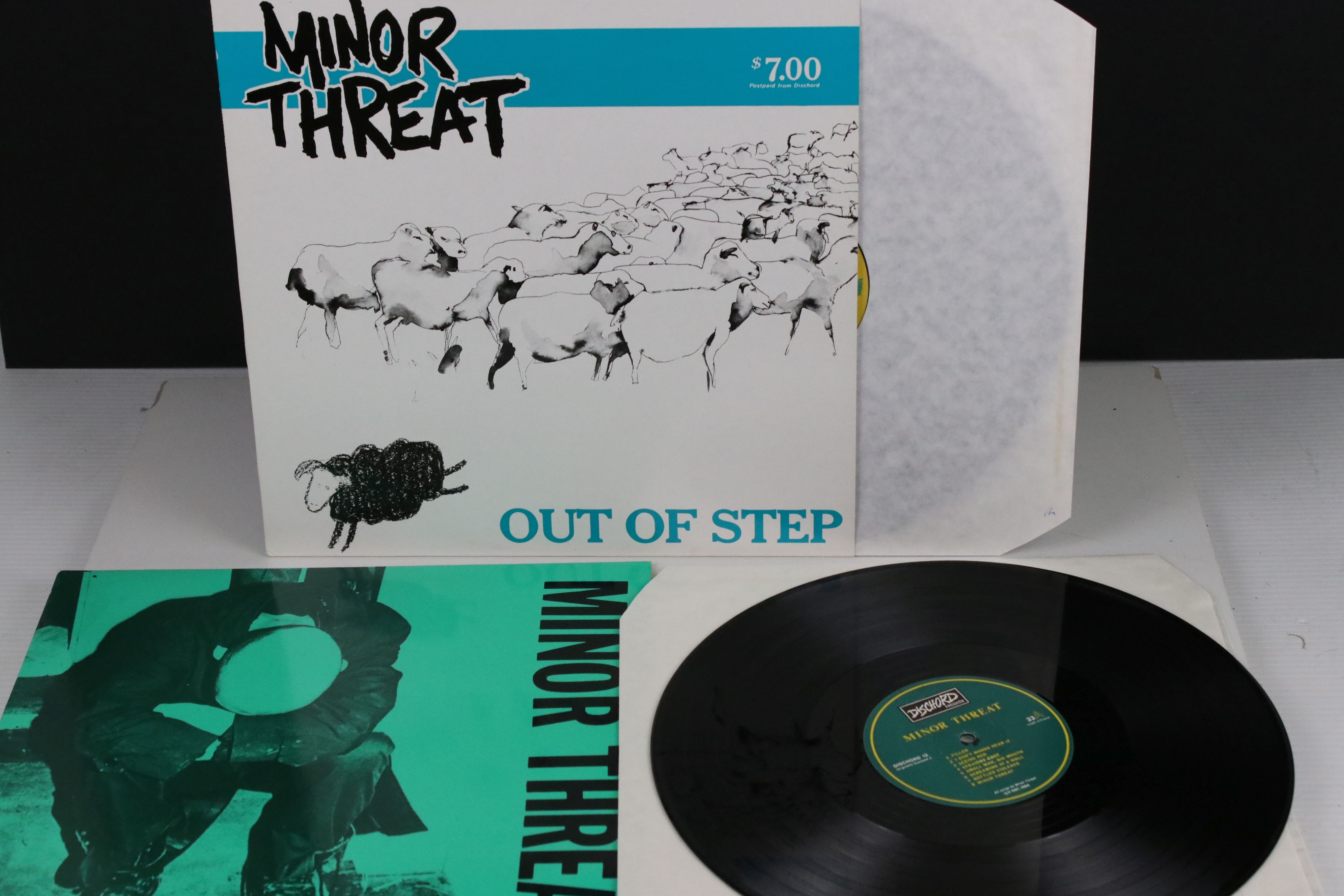 Vinyl - Two Minor Threat LPs to include Out of Step on Dischord No 10 and self titled No 13, both ex