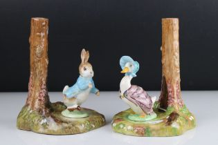 Two Beswick Beatrix Potter Candlesticks in the form of Jemima Puddle Duck and Peter Rabbit, circular