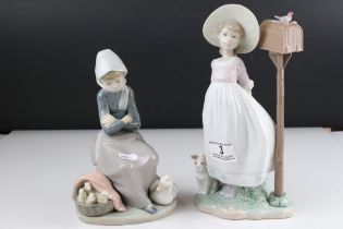 Two Lladro figures in the form of girl with duck and ducklings and a girl with dog by post box.