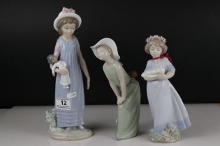 Three Lladro figures to include Girl holding chicken, Girl looking coy and Girl holding doll.