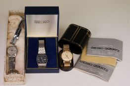 A boxed Seiko SQ gents day / date quartz wristwatch together with another Seiko and a Sekonda.