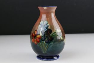 Moorcroft Baluster Shaped Vase in the Anemone pattern, 15 cm in height.