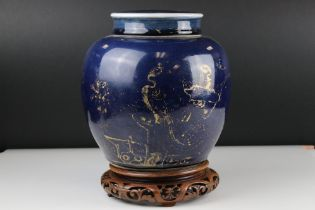 Chinese Blue ground ovoid lidded Vase with rubbed gilt decoration, 22 cm tall together with a carved