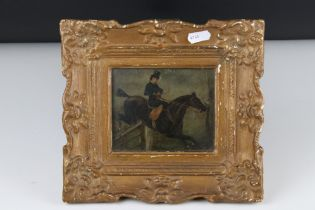 Small gilt framed oil painting of a lady on horse jumping a gate, 10 x 12 cm.