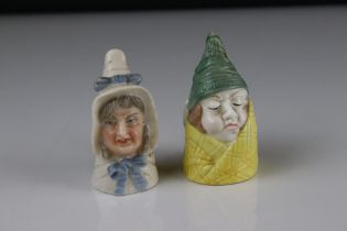 Two Royal Worcester Candle Snuffers including woman in bonnet with puce mark and Mr Caudle 1976.