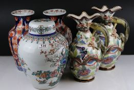 A Chinese Ginger jar with enamel peacock decoration together with a pair of Imari vases and a pair