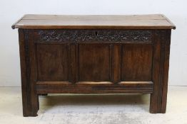 18th century or Later Oak Coffer, the three panel front with floral carved frieze, 115cms long x