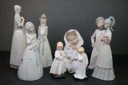 Nao Figure of a Young Child wrapped in a Blanket together with Five Spanish Lladro style Figures