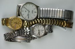 A selection of three Seiko SQ watches to include a gents and two ladies examples.