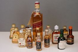 A small collection of miniatures to include Bell's Whisky and Lambs Rum together with a bottle of