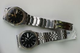 Two vintage Seiko 5 day / date automatic watches.