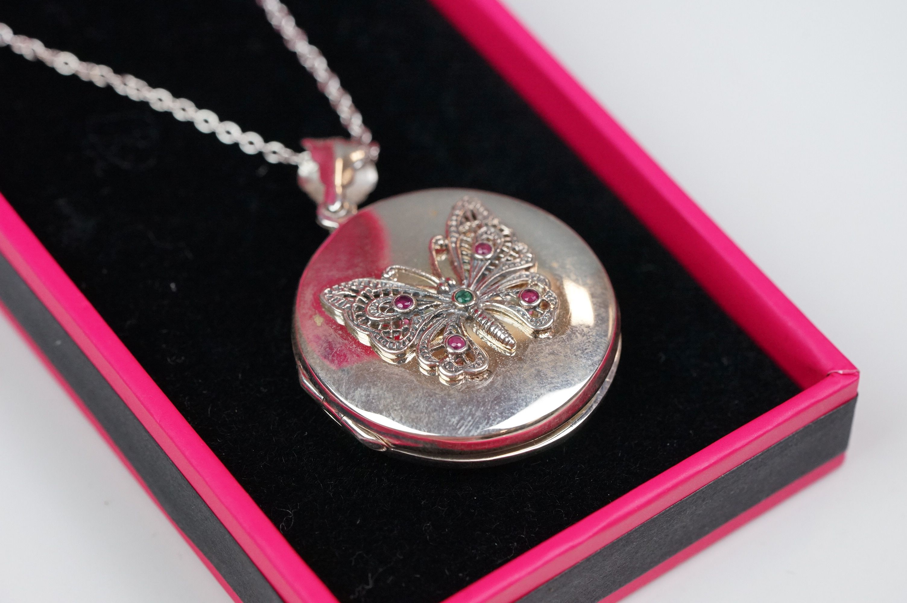 Silver butterfly locket on a silver chain