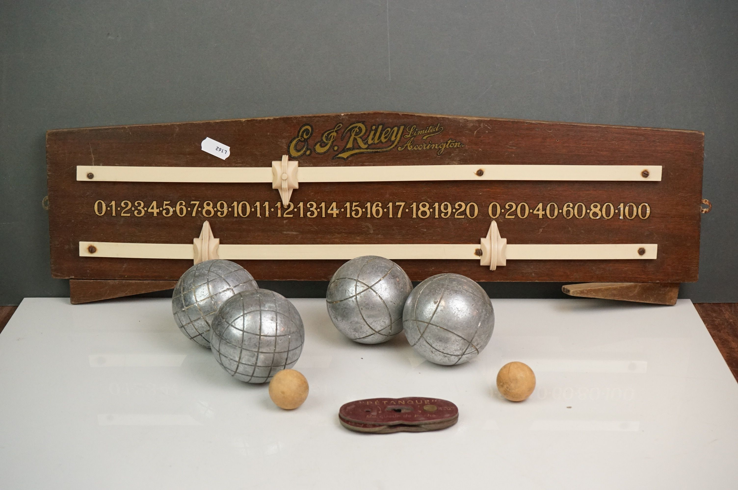 A vintage Riley snooker / billiards score board together with two boxed sets of boules.
