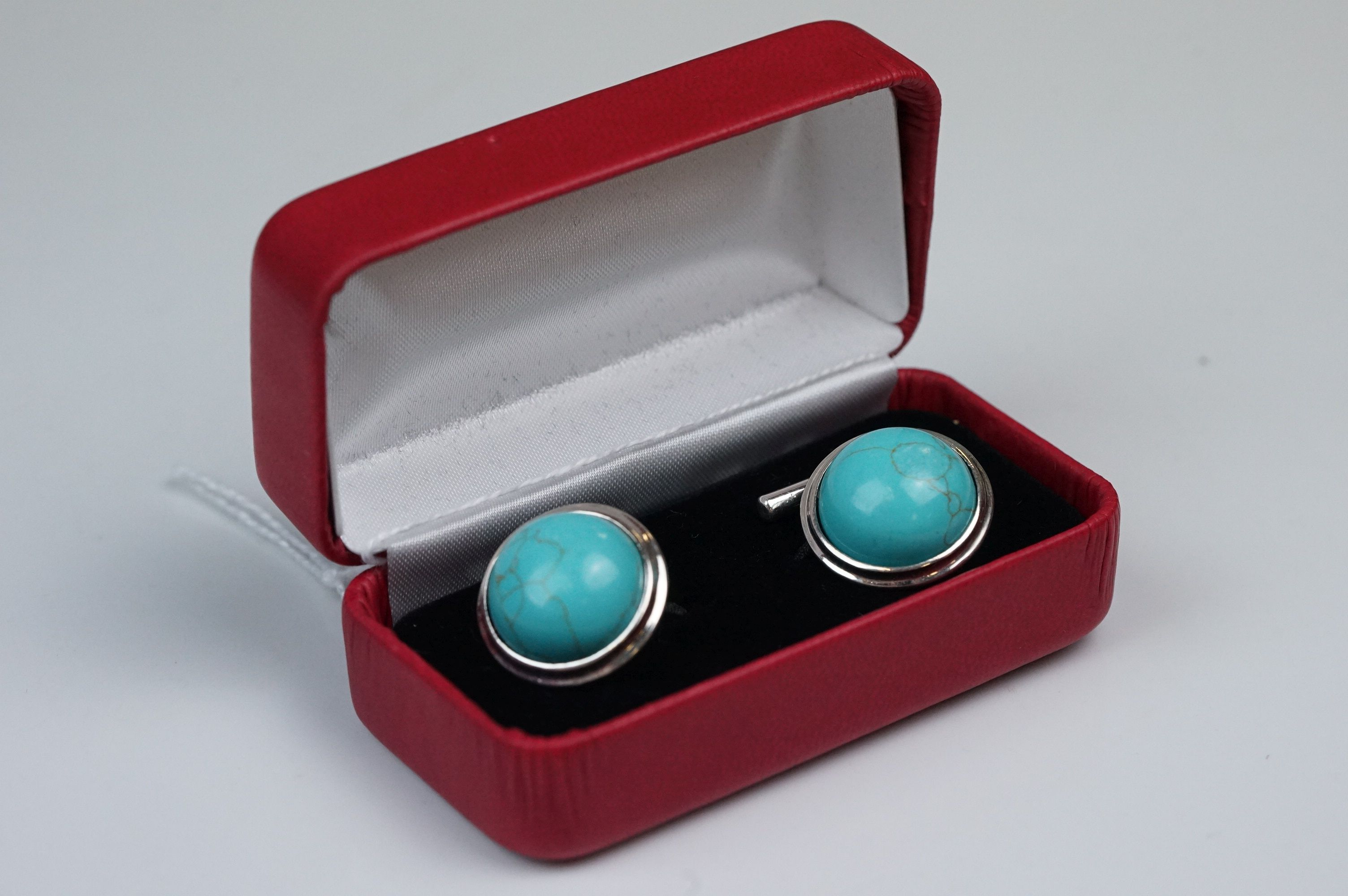 Pair of silver and turquoise set cufflinks, stamped 925