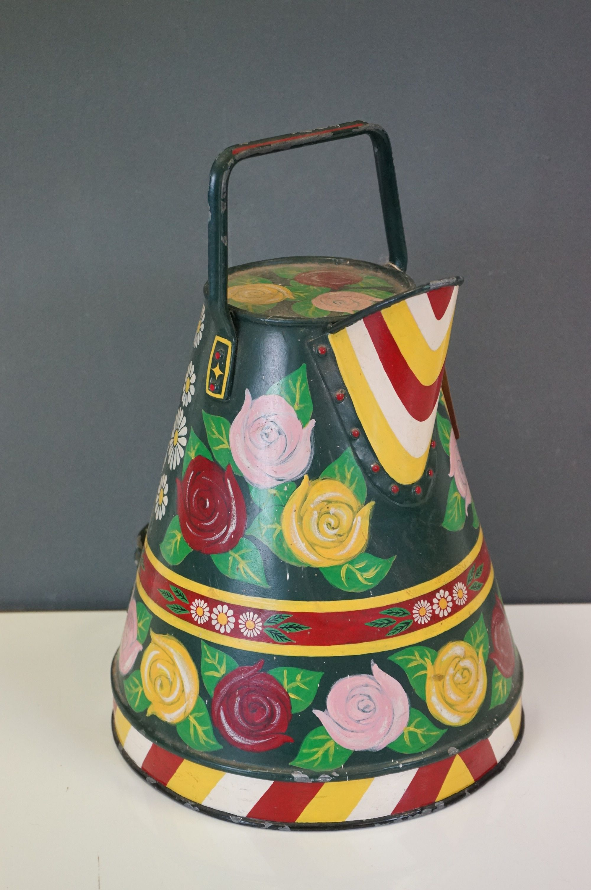 A barge ware water can with hand painted floral decoration.