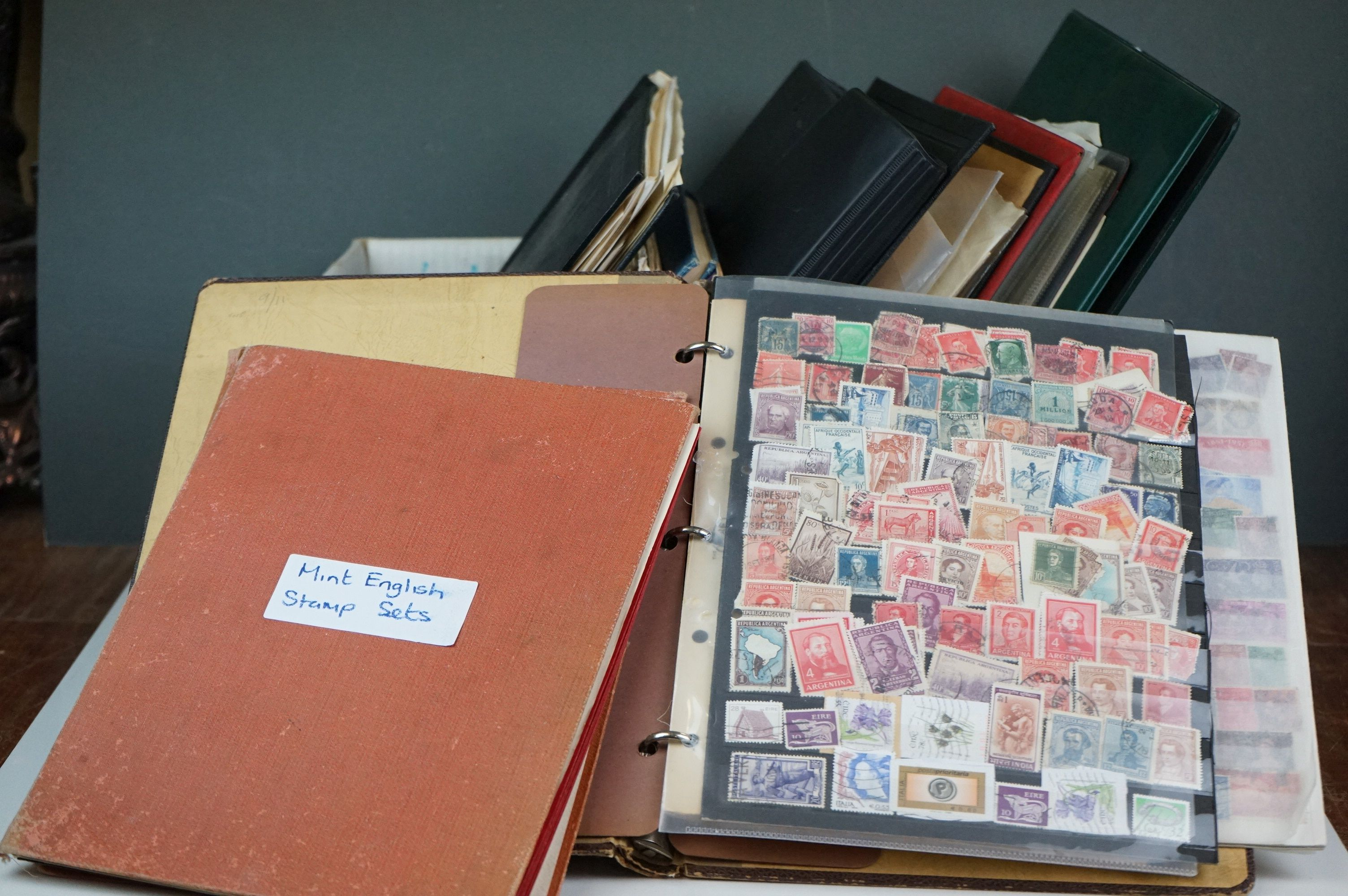 A large collection of British, Commonwealth and world stamps contained within albums.