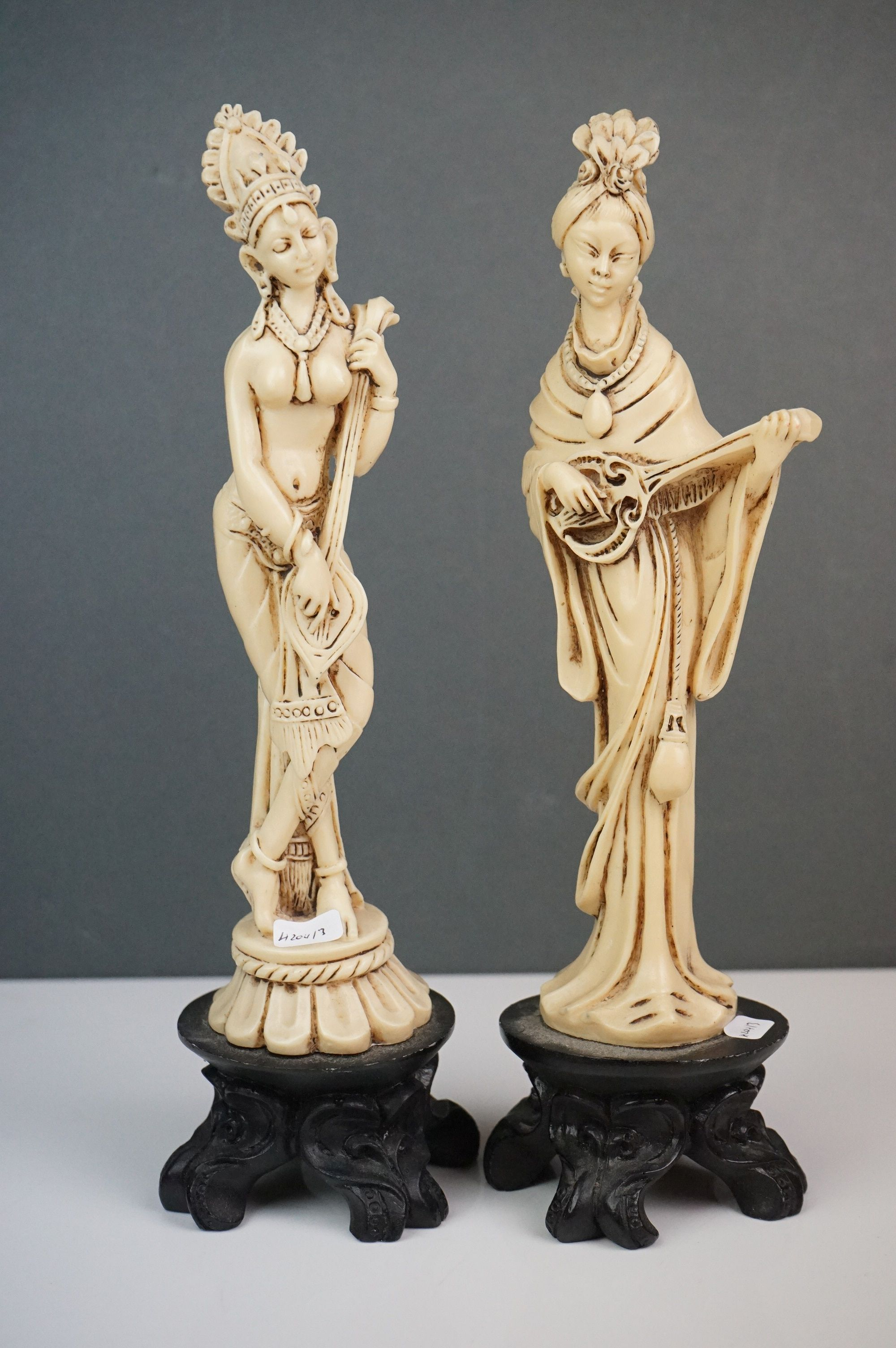 Three resin figures, to include two of women playing instruments & one deity, together with an - Image 2 of 6