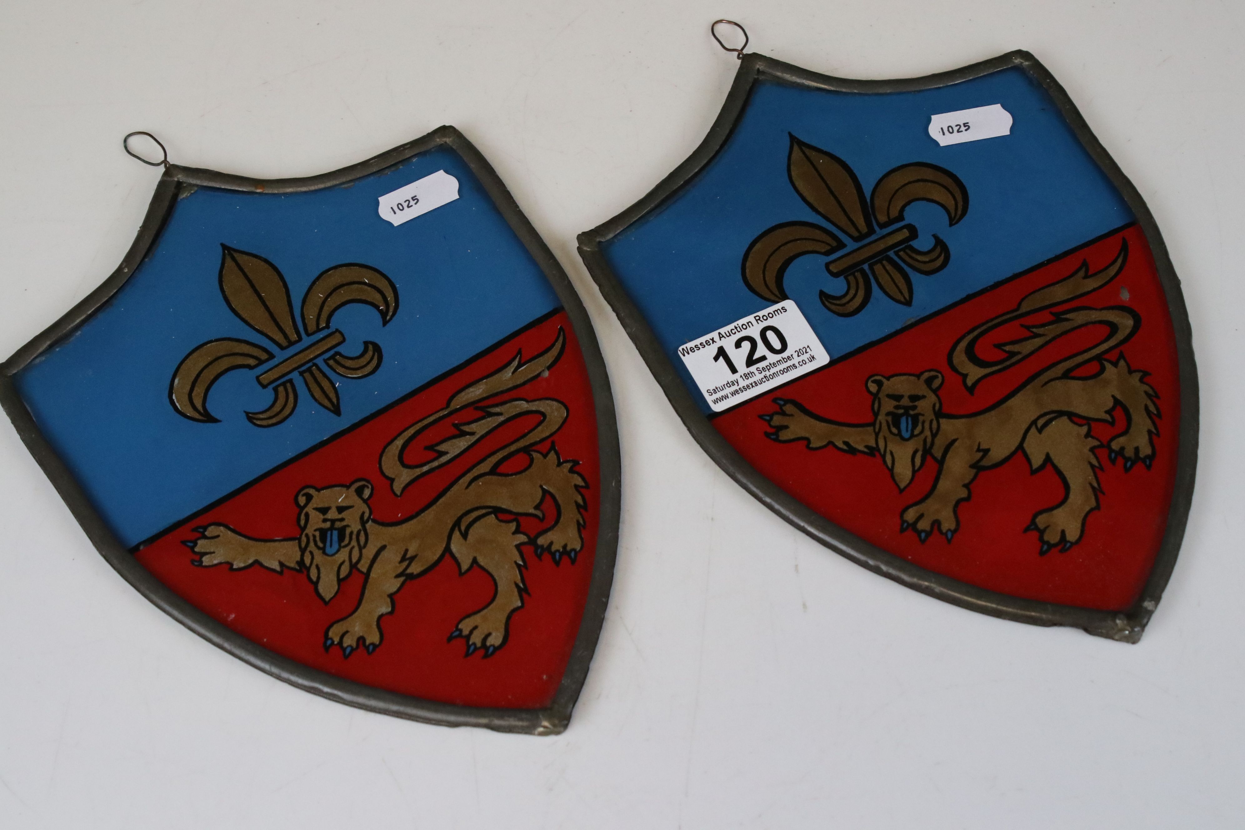 Pair of Heraldic Stained Glass Panels reverse painted with Fleur De Lys and Lions, contained in