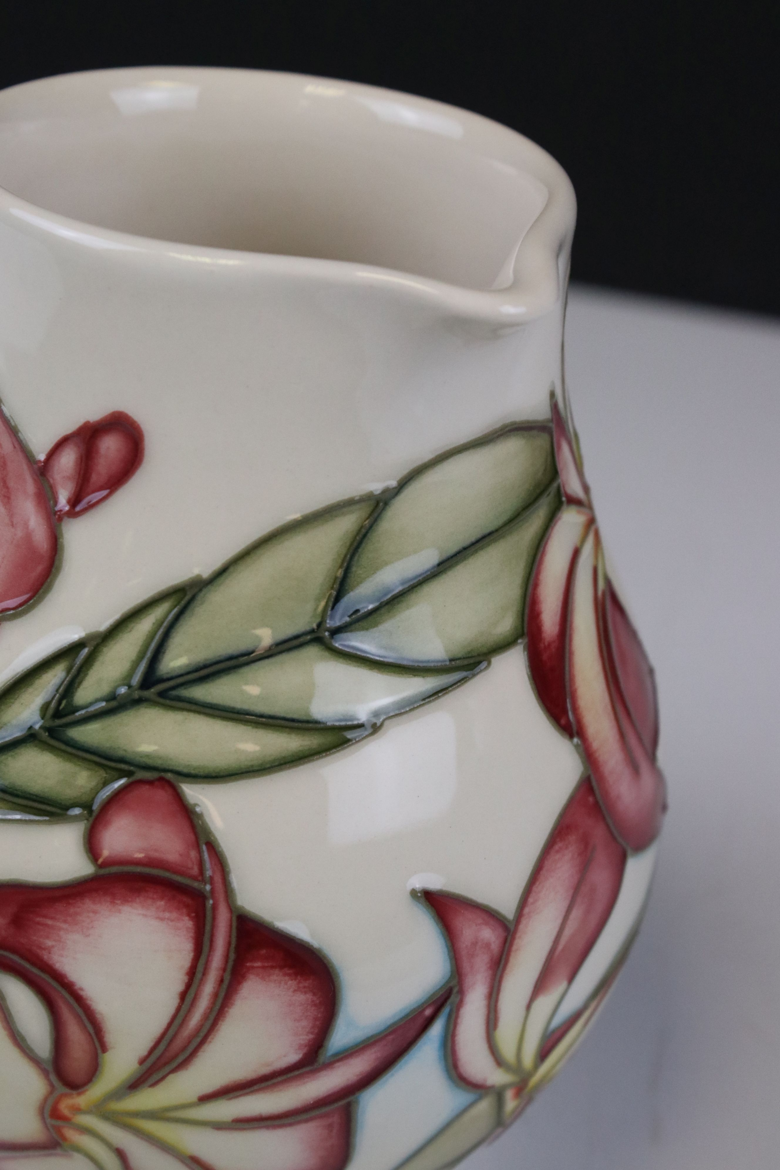 Moorcroft Jug in the Frangipani Plumeria pattern on a white ground, 15cms high - Image 3 of 4