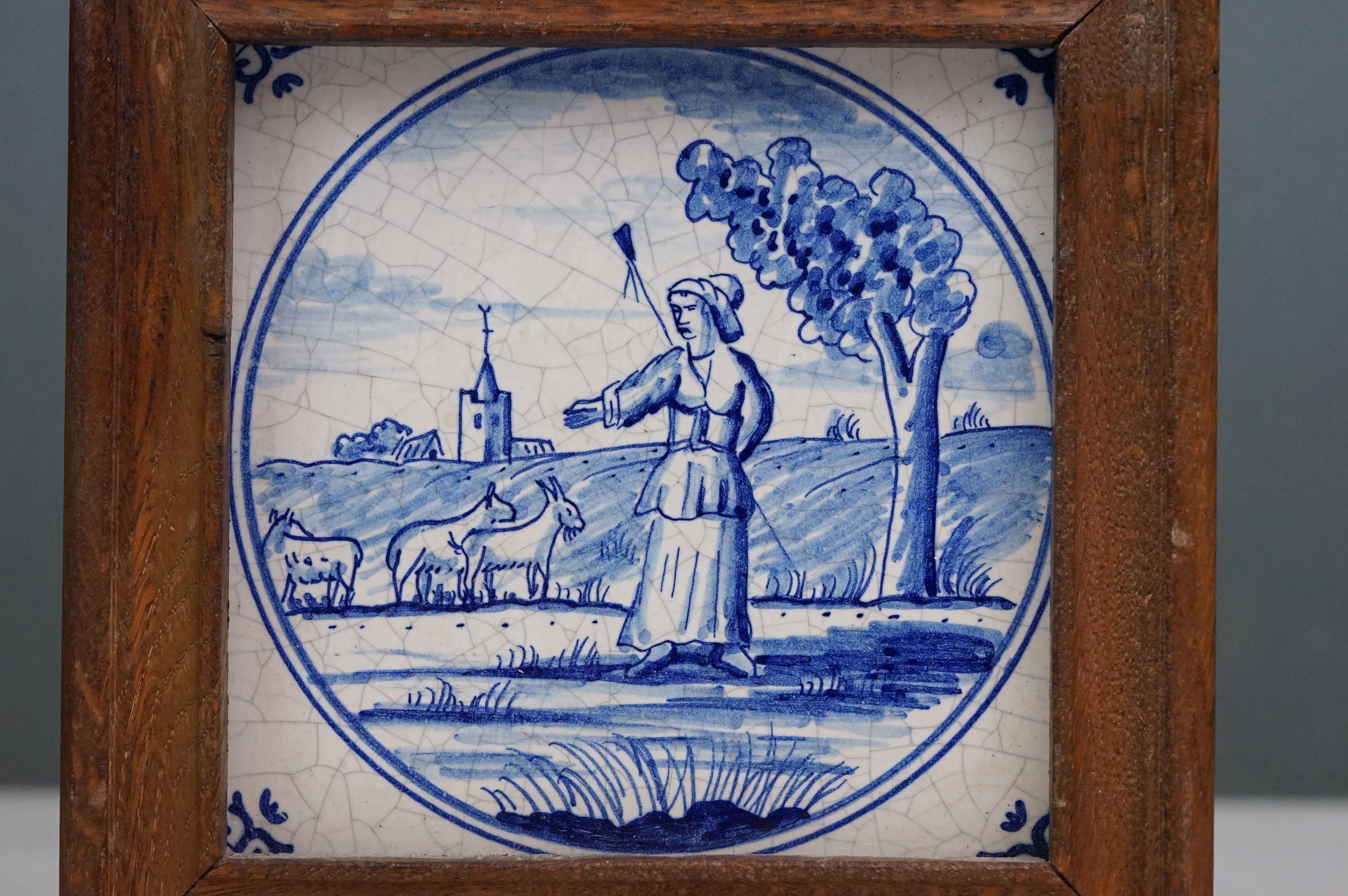 Dutch Delft-style blue and white tile depicting a shepherdess with goats, impressed dove mark to - Image 2 of 4