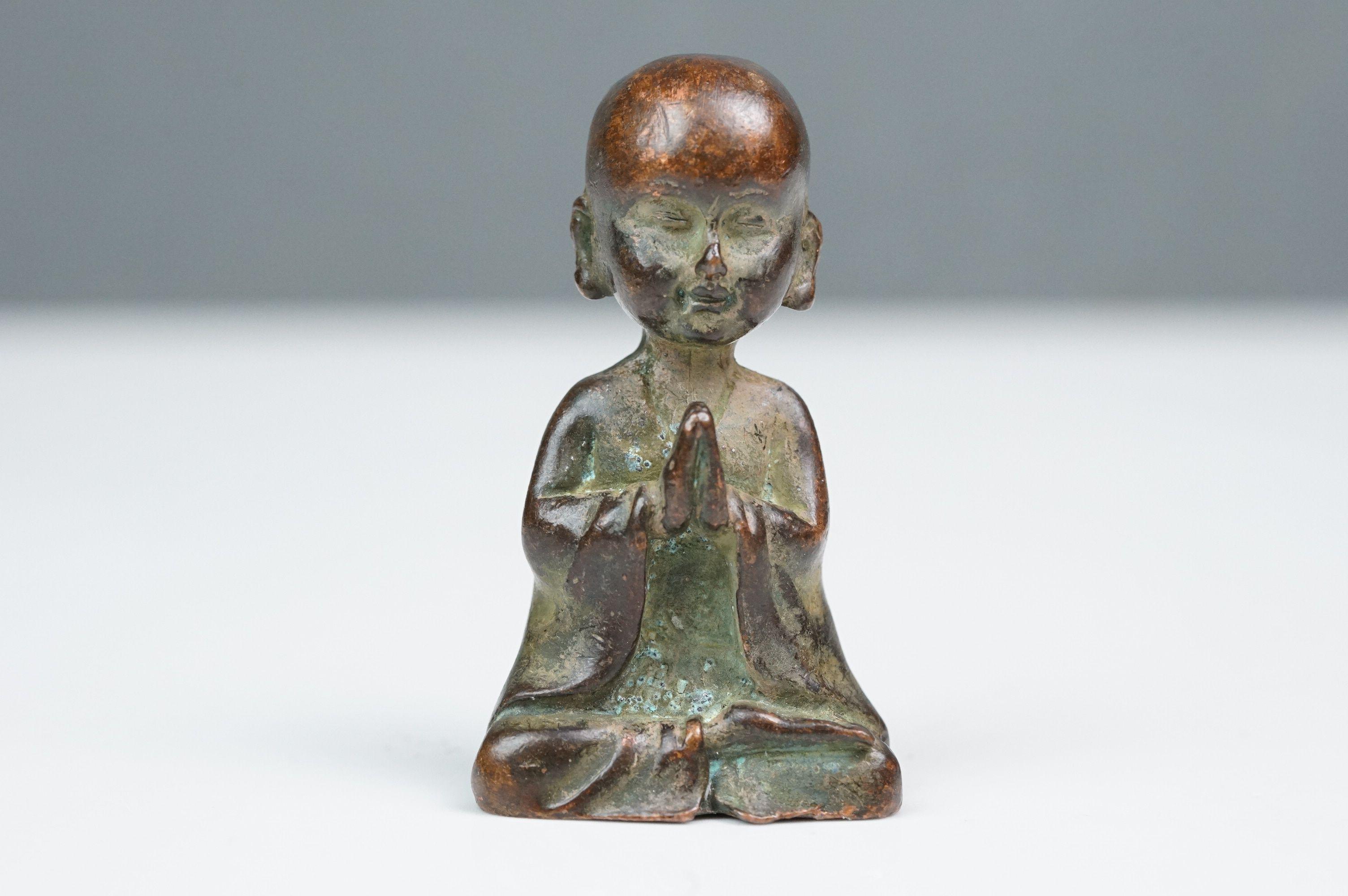 Bronze seated Buddha at prayer