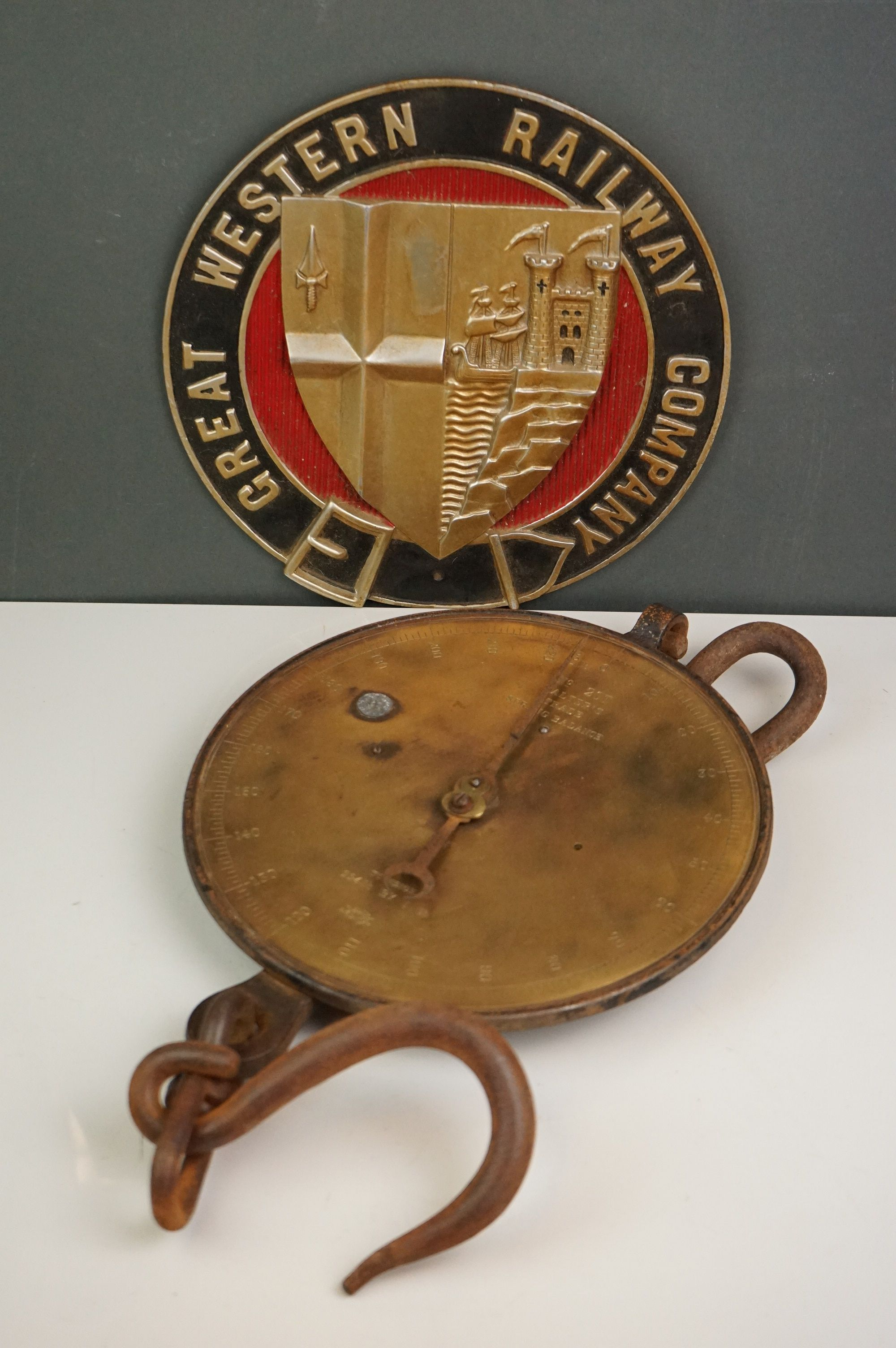 A set of vintage brass Salters scales No.20T together with a Great Western Railway wall plaque.