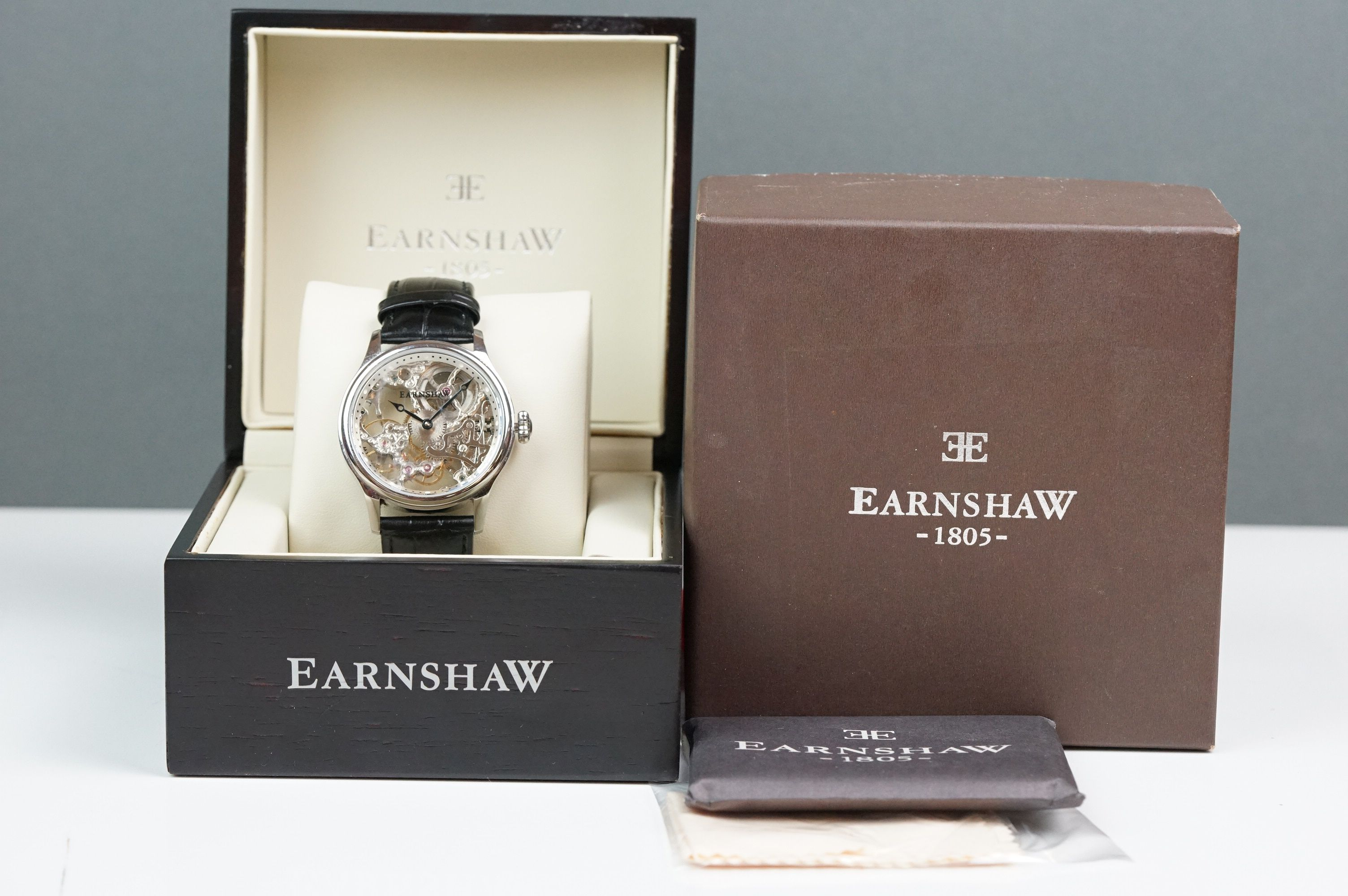 Earnshaw Gents wristwatch, skeleton face and dial, WR 5 ATM 8049, together with paperwork, box and