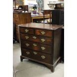 George III Oak and Mahogany Cross-banded Chest of Two Short over Three Long Drawers, raised on