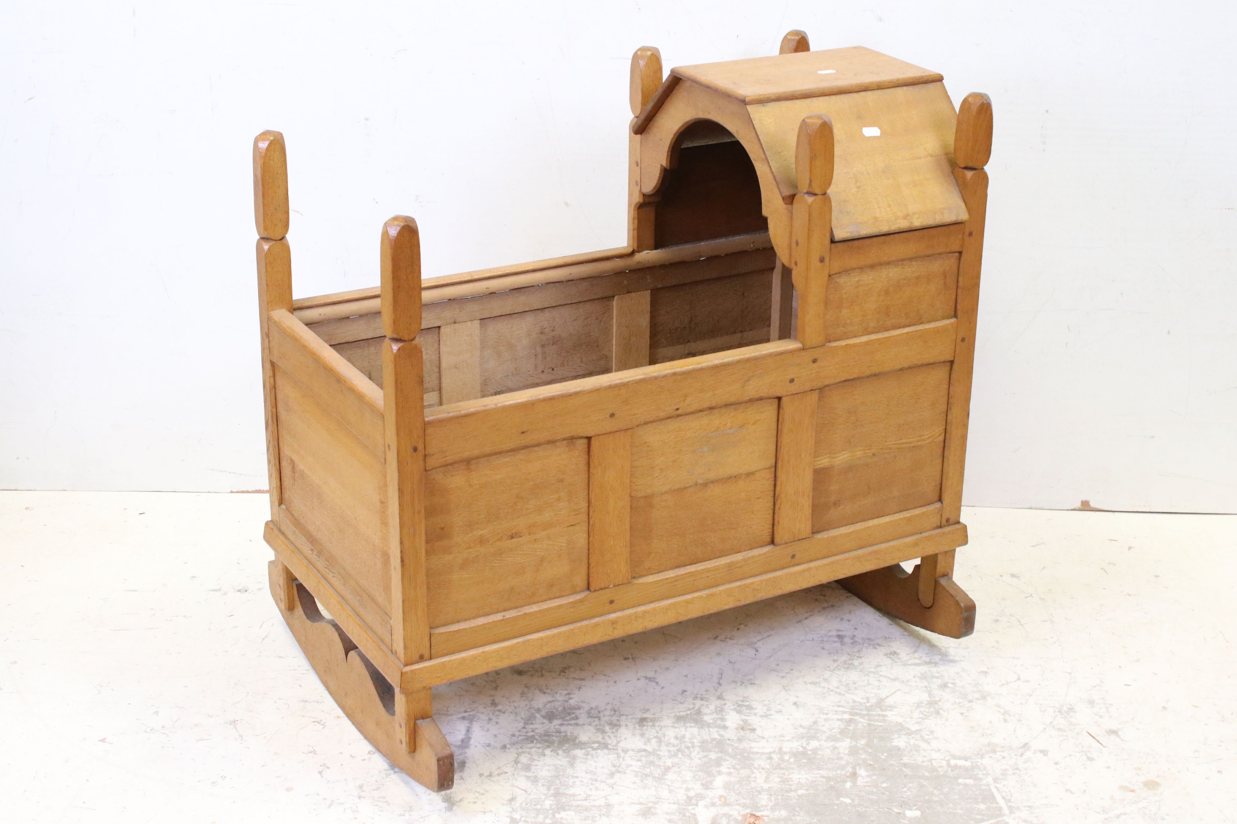 Oak Rocking Crib of panelled construction in the Cotswold School manner, 81cms long