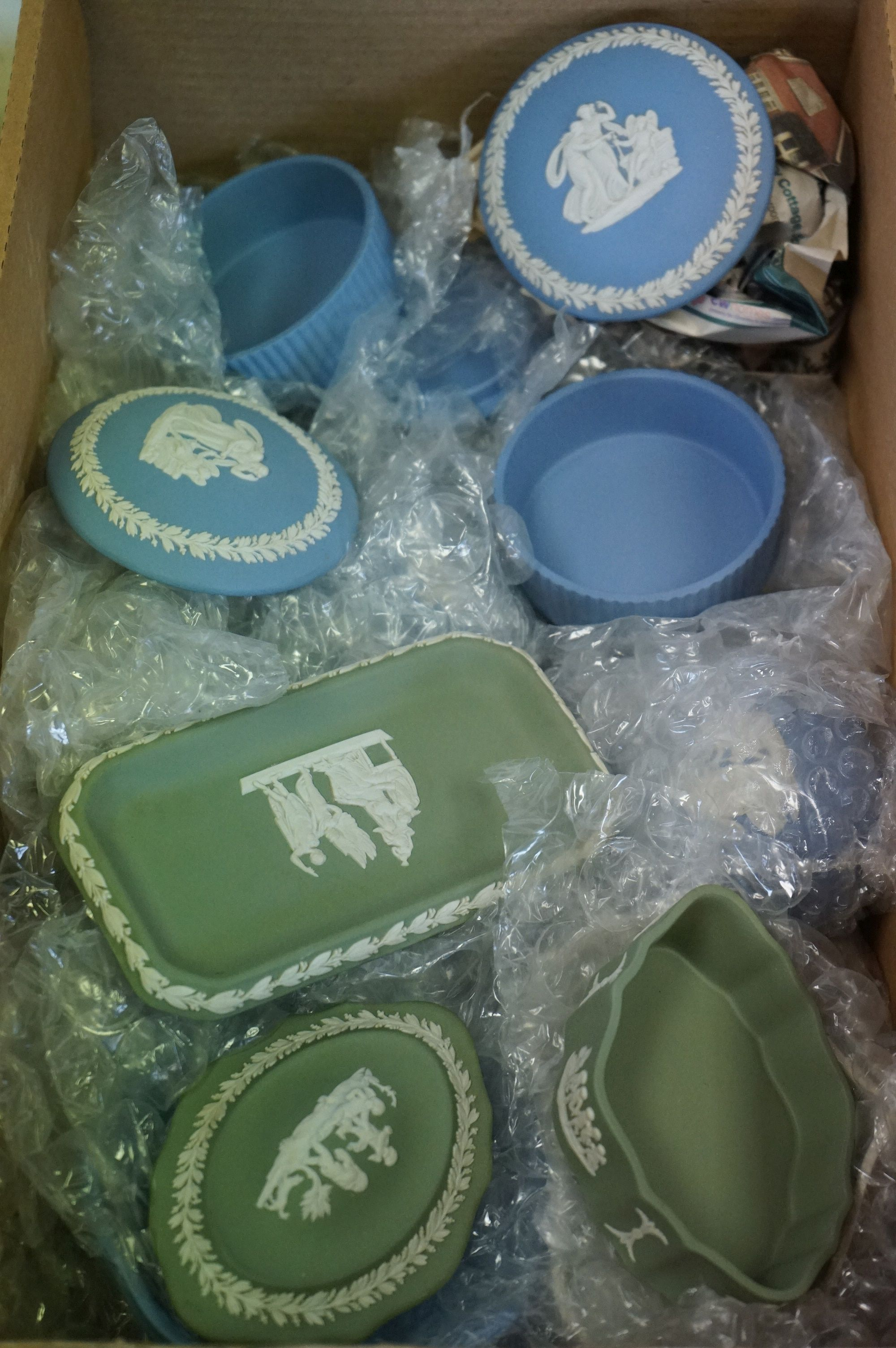 A collection of Wedgwood jasper ware to include trinket boxes and pin dishes.