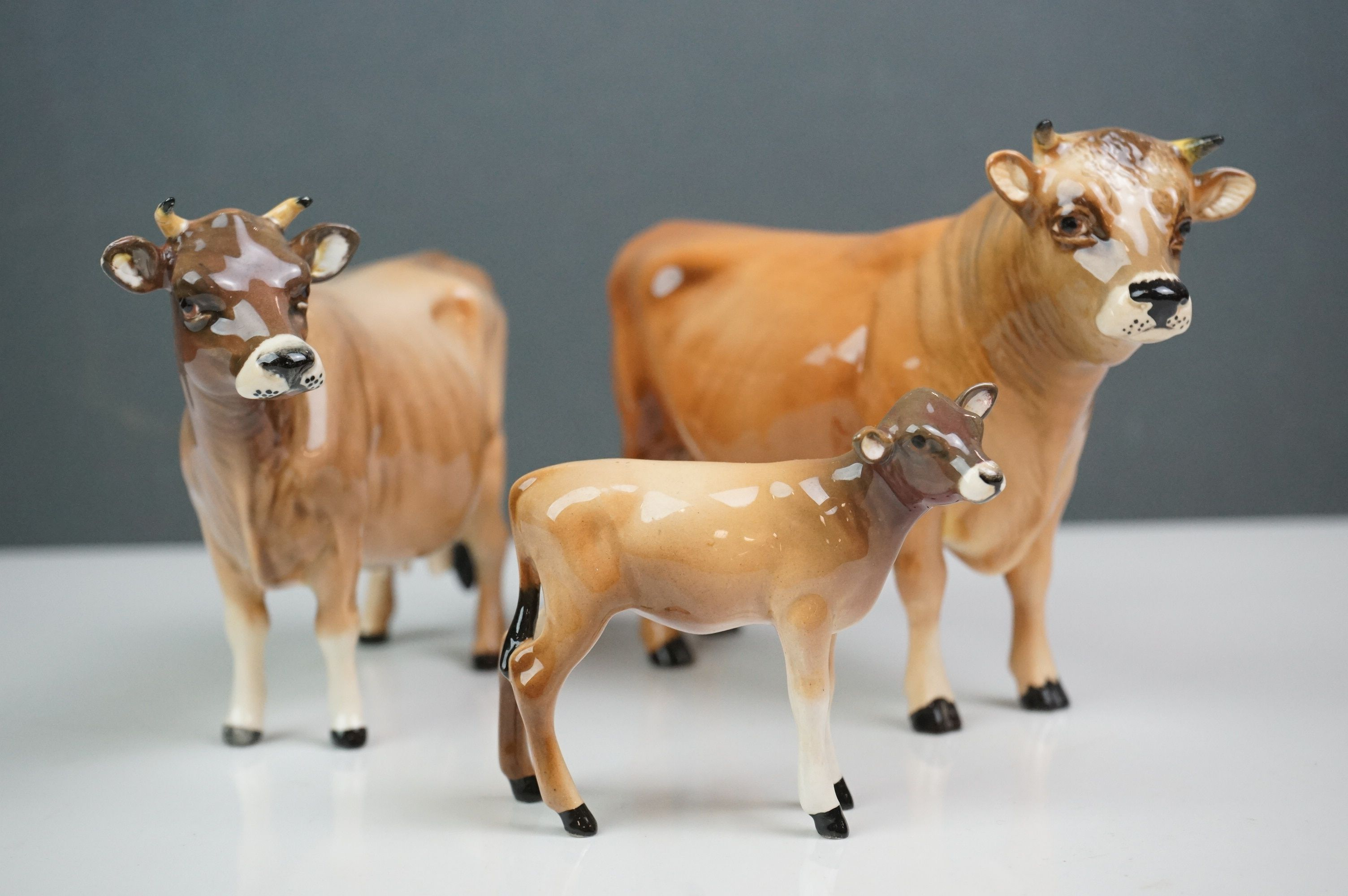 Beswick Jersey Family including Jersey Bull Ch. Dunsley Coy Boy (no.1422), Jersey Cow Ch. Newton